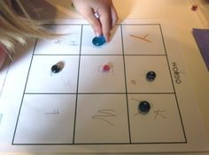 """""""wordo"""" game...laminate main bingo sheet and this can be modified for several grades (letters, numbers, words)"""