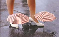 This lady who is wearing these shoes must have been pretty worried about her shoes.  They needed their own umbrellas.