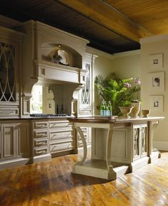 Habersham - available via Oviatt Design.  Gorgeous kitchen, white, with excess detail fabulous island