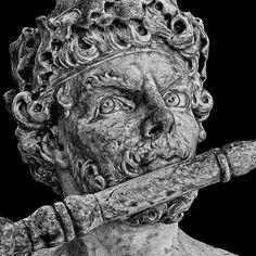 Man plays his flute, Louvre, Paris.  Copyright 2015 Michael McLaughlin.
