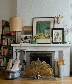 Living room fireplace + painted brick + art