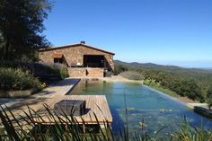 Architecture studio in Barcelona specialized in modern sustainable design. Contact us to build your dream! Natural Swimming Ponds, Infinity Pool, Farmhouse Renovation, Stone Houses, Pool Designs, Jacuzzi, Exterior Design, House Design, Design Design