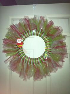 Red, green and white glitter tulle wreath with a Santa and tree embellishments!!