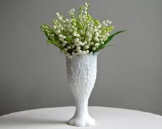 WHITE MILK GLASS, WE HAVE PURCHASED TONS OF VINTAGE WHITE MILK GLASS TO USE AND TO DECORATE WITH..........IN THE VASES THERE WILL BE ALL KINDS OF SPRING FLOWERS, PASTELS AND BRIGHT,