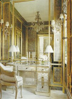 Ahhh- one of my favorite uses of mirror- Dressing rooms and bathrooms....Make sure when adding antique mirror to interiors, use clear mirror where someone really needs to look at themselves, but the rest of the space can be in antique mirror. It doesn't take away from the look at all.