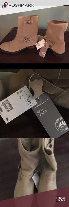 Premium Suede tan boots brand new woman's 9 1/2. Beautiful quality suede boots with a sturdy tread, by H&M. NWT. Women's size 9 1/2. Open to offers. Please feel free to ask questions, and I'm happy to provide more pictures. ✨SORRY, NO TRADES✨ Smoke, and pet free home. Thank you for visiting my closet, Heather H&M Shoes Combat & Moto Boots