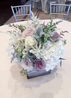 Flower by Bella Fiori Floral & Event Design www.bellafiorievents.com  green, purple, grey, and white, vintage, rustic, bouquet, winter theme centerpiece, ceremony, escort card, sweetheart, cake, wedding flowers