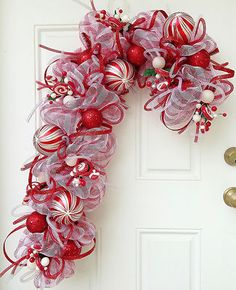 Candy Cane Deco Mesh Wreath With 10 ornament balls and 6 candy decorations.  I am going to do this, I have the red white mesh now I need the accessories.  Too cute.