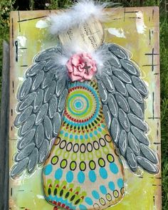 Introducing 'Angel Blessings' this is a 11x17 mixed media piece on wood. The fabric is from Nepal the wings are mad from wooden biscuits and cardboard. I also used feather boa paper flower acrylic paint sharpie white out pen paper ink music from a 1906 book of Mozart cardboard enjoy and let me know your thoughts on this piece.... #kimberlymcguinessart #mixedmediaangels #mixedmediaartist