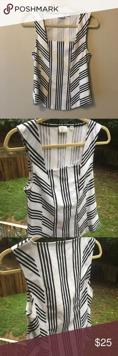 Postmark Anthropologie top Adorable postmark stripe top! Classic black and white with a hear and there stripe pattern! Very versatile! Great stretch- the strap is wide enough to wear a bra! Square neckline! Anthropologie Tops Tank Tops