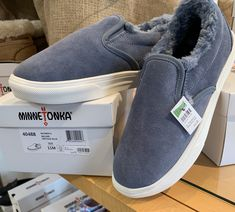 "Yes, please - the Minnetonka ""Wilder"" shoe at Zing. Genuine suede upper, soft pile lining, and featherlight outsole. From couch to coffeeshop, this is style and ease. We carry sizes 7 to 11."