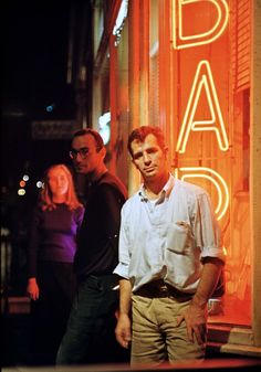"""Author Jack Kerouac is seen outside the bar Kettle of Fish on New York's Bleecker Street, Oct. 15, 1958 after leaving a publisher's party for his book """"The Dharma Bums."""" Woman in background is author Joyce Johnson. (AP Photo/Jerry Yulsman) AP"""