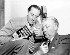 Basil Rathbone and Nigel Bruce on set at NBC doing a bit of clowning around with a copy of 'The Complete Sherlock Holmes'.