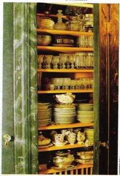 Gene Hovis' china cabinet in his Manhattan apartment...I am so jealous, I have dish envy...