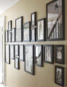 Decoração com fotografias em corredor