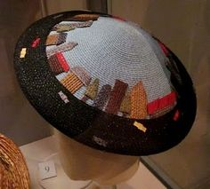 Jennifer Ouellette hat -- adore anything with a cityscape round the edge!!
