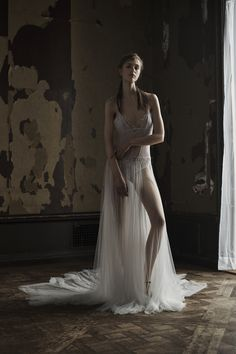 Light ivory stretch illusion V-neck gown with French tulle skirt accented by hand embroidered crystals. Styled with bow belt and Chantilly lace bra and panty.