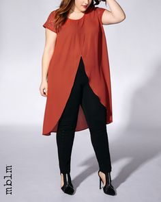 For stunning allure, try this stylish plus-size blouse from mblm! Made with a sheer chiffon fabric, it has a crossover design at front, short sleeves with metallic studs, a rounded neck and a knee length. Wear it with a black pant and heels for a night out!