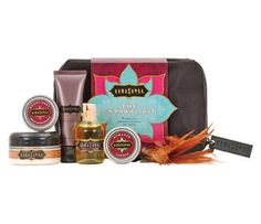 Kama Sutra Getaway Kit -  This collection of Kama Sutra products fits nicely into your luggage and carry-on and are perfectly sized under 3.4 oz to meet flight regulatory standards. You'll have everything you need tucked away with this soft, reusable carrier case, complete with a Kama Sutra logo zipper! This kit contains .75 oz Vanilla Creme Oil of Love, 1.8 oz. French Vanilla Body Souffle, 1 oz. Love Liquid Lubricant, 2 oz. Sweet Honeysuckle Honey Dust and feather duster, and romance candle.