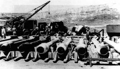 """""""Thin Man"""" Plutonium Gun Type Bomb Casings in 1944. In the background you can see """"Fat Man"""" casings. It is unknown whether they are the early Model 1222 """"Fat Man"""" casings, which required 1,200 bolts to assemble, or the later Model 1561 casings which were substantially easier to assemble and which were used for the production versions."""