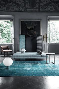 Aqua rug, chaise, painted ceiling, crown moulding, windows, light, chair, side table, sitting room, painting