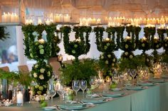 Structure made of greenery, white flowers with a cage filled with candles on top Green Chandeliers, Fantasy Wedding, Italy Wedding, Celebrity Weddings, Luxury Wedding, Wedding Centerpieces, White Flowers, Flower Arrangements, Floral Design