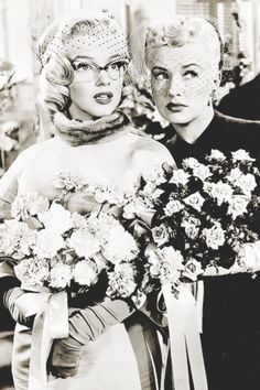 Marilyn Monroe and Betty Grable in'' How To Marry a Millionaire ''(1953)