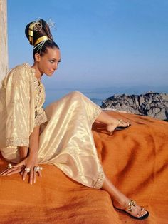 Marisa Berenson is wearing a golden silk caftan by Tina Leser, photo Henry Clarke, 1967