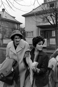 Elvis Presley's grandmother and Priscilla Beaulieu leave the house that Elvis and his family occupied in Bad Nauheim, Germany, March 1960.