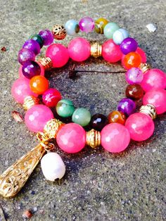 Gorgeous Faceted Jade Bead Bracelet In Neon Pink, Whith a Freshwater Pearl Charm. By OohLalaGems. on Etsy, $56.00