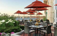 Evo Dining Chairs, La'Stratta Dining Tables and Basta Sole Umbrella at Aragosta Bar and Bistro in Boston, MA