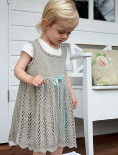 Vine Lace on the skirt of this little dress ~~ Celebrating Family by Debbie Bliss - Babies - For - Patterns