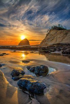 Sunset over Haystack Rock, Cape Kiwanda Oregon  (by Michael Brandt on 500px)