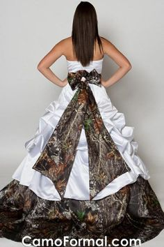 Wedding dress with camouflage trim at the bottom and band with a bow.