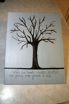 """Baby shower: My sister painted this canvas and then I had paint for guests to create """"fingerprint leaves."""""""