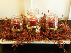 love the jars, candles, berries...not sure about the rocks...maybe acorns or rose hips or putka pods...