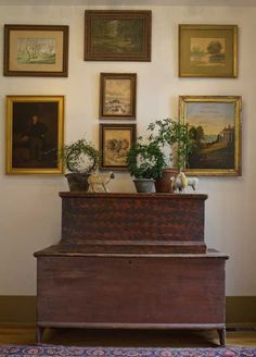 A gallery wall in the new addition showcases 19th-century primitive drawings and paintings (including several by Clarence Ball, a prominent local artist), hung over a stack of 1840s six-board blanket chests.