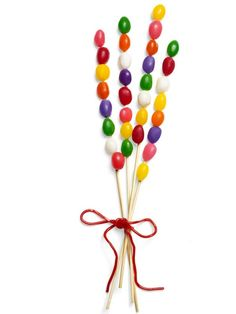 Jelly beans on skewers to add to an Easter centerpiece.  If giving to children, cut off sharp points before serving.