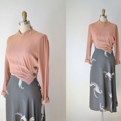 Pink and gray Kay Collier dress with whimsical, swirl angels novelty print; c. late 1930s to early 1940s