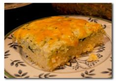What to do with giant zucchini.. shred it and make my favorite zucchini casserole.. more like a quiche with rice and eggs and LOTS of cheese of course!