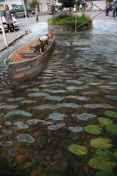 """"""" Et au milieu coule une rivière."""" ( film de Robert Redford ) / 3D Street. / By Julian Beever."""