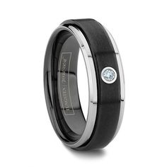 VULCAN 6MM/7MM/8MM   This ring takes two-tone black ceramic and tungsten rings to the next level with a solitaire diamond set into its center. The popular beveled design of the tungsten is accompanied by a raised black ceramic center and finished with a 5 point solitaire diamond. The Vulcan is the perfect combination of a two tone style and a classic brilliant looking diamond.