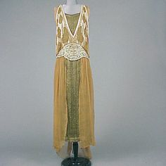 Coffee Chiffon and Lame Party Dress  American, circa 1918   Comprising a sleeveless gold and black lame underdress and a dress of gossamer chiffon, the bodice with low V front, beaded with rows of pearlescent bugle beads with irregularly shaped negative spaces, a wide shaped heavily beaded belt at natural waist level, and an open skirt fashioned from draped panels attached only at hem, size 8, labeled: Louis/ Cerlian/36 East 49th Street/New York.