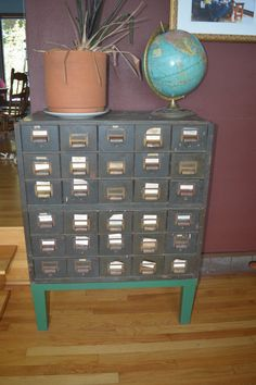 this would fit in any room i spend time in. it has little drawers ...