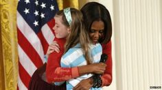 First Lady Michelle Obama hugs Charlotte Bell, at the White House's annual Take Our Daughters and Sons to Work Day 24 April 2014. Girl gives father's CV to US First Lady Michelle Obama A young girl offered US First Lady Michelle Obama her father's CV during questions at the White House's Take Our Daughters and Sons to Work Day. #USA #WhiteHouse #MichelleObama #women #girls #career #jobs