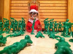 Trap your elf in an upside-down glass cup or vase. Set up your toy soldiers around him as if he had been captured overnight sneaking back into the house from the North Pole.