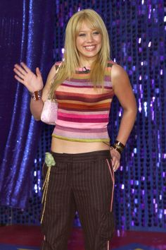 Hilary Duff has had quite the Hollywood evolution. From her breakout role as a little witch in Casper Meets Wendy to her iconic Disney Channel role on Lizzie 2000s Fashion Trends, Early 2000s Fashion, Casper Meets Wendy, Divas, Fashion Through The Decades, Pinstripe Pants, Stars Then And Now, Budget Fashion, Hilary Duff