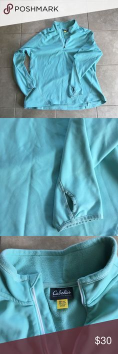 Cabela's Fleece Lined Sweatshirt Beautiful turquoise sweatshirt. Features high/low hem line, front quarter zipper, and thumb holes at the sleeve. Keeps you toasty with fleece lining. Make an offer! Cabela's Tops Sweatshirts & Hoodies