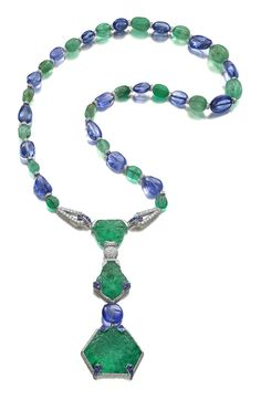 The Cartier Timken necklace, designed in 1925 and one of the most important examples of Cartier jewellery from the art deco era. It is set with three rare Mughal emeralds carved on the front and reverse weighing 71.91ct, 30.27ct and 29.21ct, sapphire beads, buff-top cabochon sapphires, emerald beads and diamonds