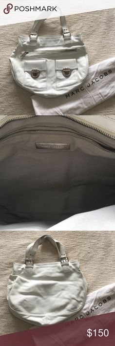 Marc Jacobs bag ~*~Beautifully restored white Marc Jacobs bag. Spent $50 just to clean the leather, looks like new except for the little bit of discoloration (see last picture) that is barely noticeable. Inside has one zippered pocket. Outside has another zippered pocket as well as two smaller buckled pockets. There are some stains on the inside. Can post more pictures of those if needed. In great condition!~*~ Marc Jacobs Bags Shoulder Bags